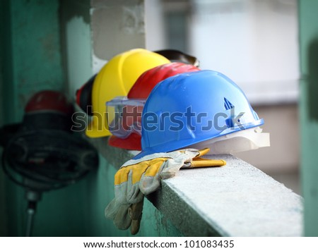 Safety gear kit close up on work place - stock photo