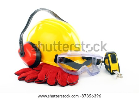 Safety gear kit close up over white - stock photo