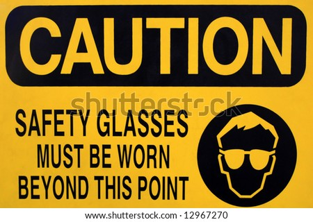 Safety glasses caution sign, isolated on white. - stock photo