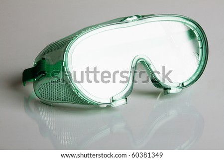 Safety glasses on gray background