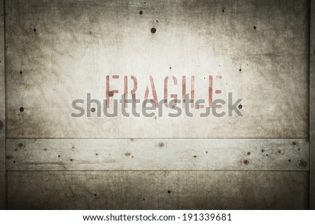 Safety,Grung fragile rubber stamp on cargo box - stock photo