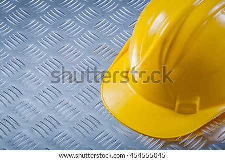 Safety hard hat on channeled metal background construction concept. - stock photo