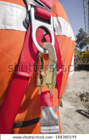 Safety harness Close up view of the security clamp used to be suspended in high altitudes  - stock photo