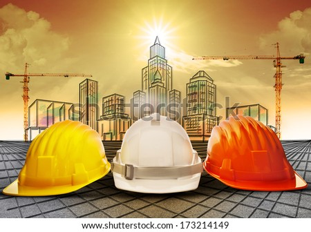 safety helmet and building  construction sketching on paper work use for construction industry business and architecture engineering topic - stock photo