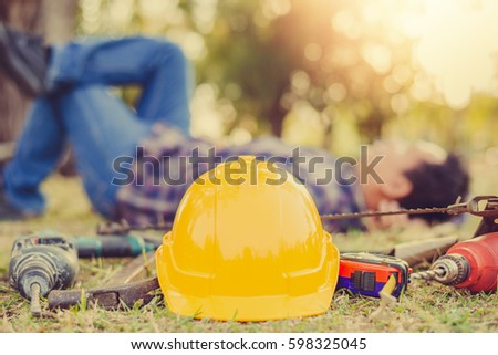 safety helmet and Equipment technician with craftsman background blur