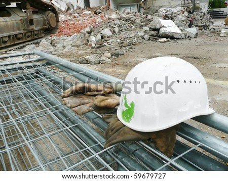Safety helmet and gloves on the construction site - stock photo