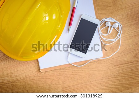 safety helmet, clipboard, notebook, pen on wooden table. top view. Construction concepts - stock photo