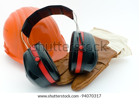 Safety helmet, hearing protection and work gloves - stock photo