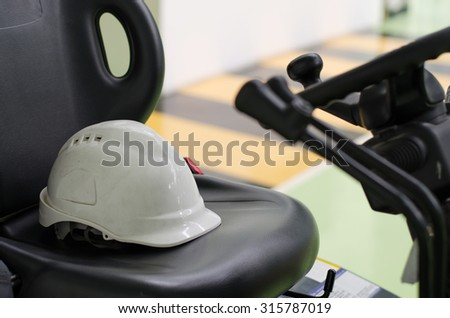 Safety helmet used on the leather seats - stock photo