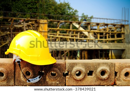safety helmet with blur under construction building - stock photo