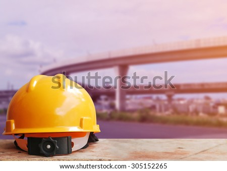 Safety helmet with highway construction site background - stock photo
