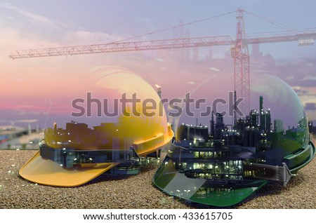 Safety in Refinery Concept , Hard hat on working table in oil refinery plant heavy petrochemical industry estate use for energy,power,fuel ,gas and fossil petroleum topic - stock photo