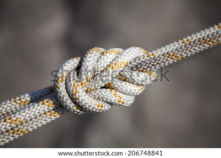 Safety knot, white rope  - stock photo
