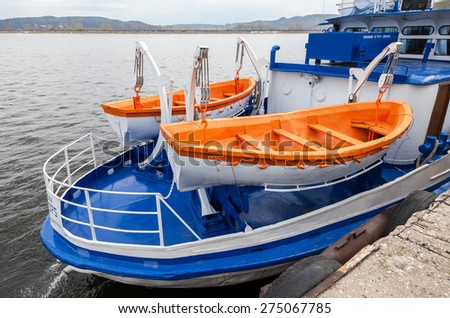 Safety lifeboats of the river cruise passenger ship - stock photo