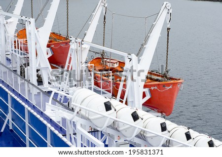 Safety lifeboats on deck of a ferry - stock photo