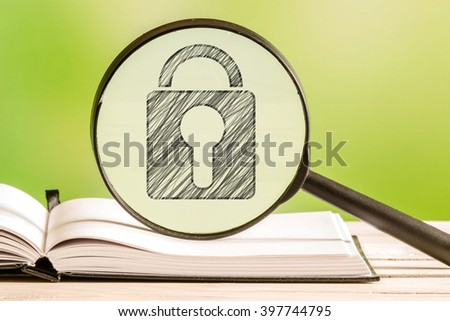 Safety search with a pencil drawing of a padlock in a magnifying glass - stock photo