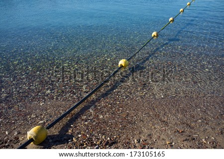 Safety swimming lane marker at sea - stock photo