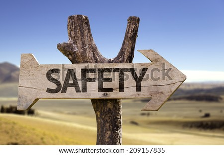 Safety wooden sign with a desert background - stock photo