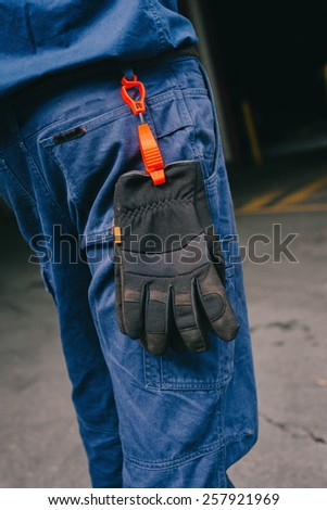 safety work pants with gloves, add your own logo. - stock photo