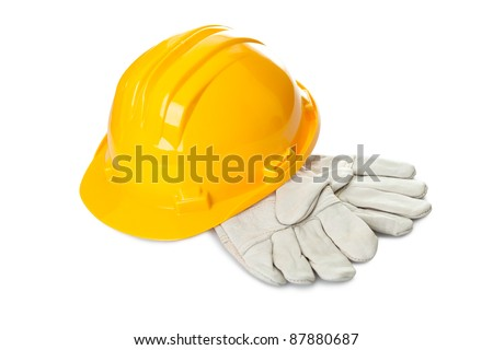 Safety yellow hard hat and industrial gloves isolated on white background