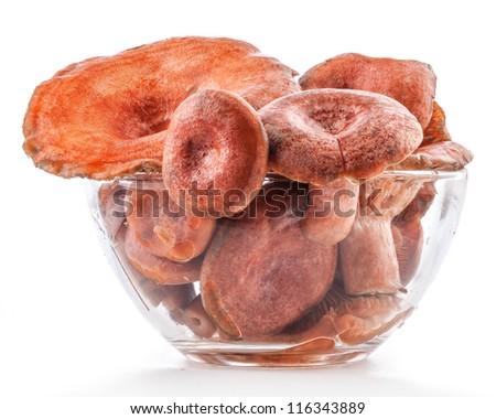 Saffron milk caps (Lactarius deliciosus) in tray isolated on white background - stock photo