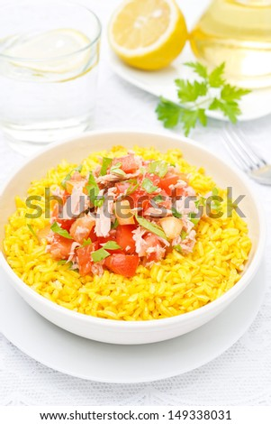 saffron rice with tuna, tomatoes, peppers and herbs, vertical - stock photo