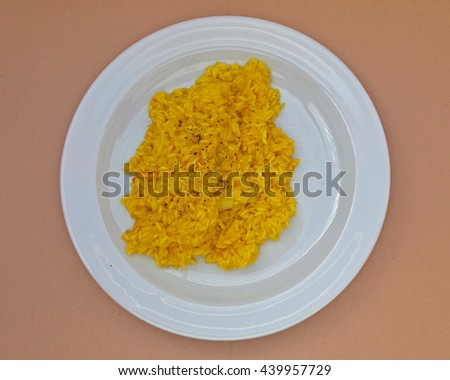 Saffron risotto made with Carnaroli rice, medium grained rice grown