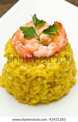 saffron risotto with fresh shrimp - stock photo