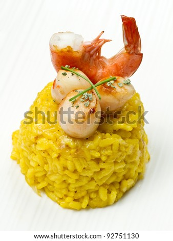 saffron risotto with grilled scallops and shrimp - stock photo