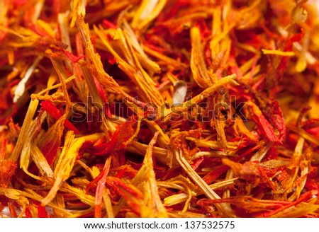 Saffron treads in pile, isolated on white, shallow dof - stock photo