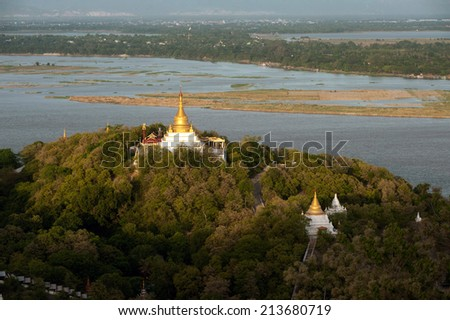 SAGAING,MYANMAR - JULY 1 : This Pagoda has the best view of Sagaing hill on The Ayeyarwaddy river from Soon U Ponya Shin Pagoda on July 1,2014 ,Sagaing Division,Mandalay,Middle of Myanmar. - stock photo