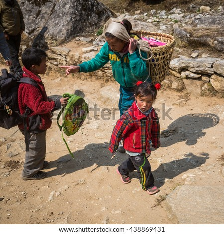 SAGARMATHA, NEPAL-APRIL 28: Himalayas people 28, 2016 in Sagarmatha, Nepal. Little girl on the track to the Everest Base Camp.