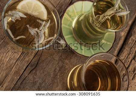 sage tea in mugs and glasses - stock photo