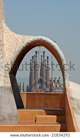 Sagrada Familia church looking through an arch, Barcelon, Spain (Note: Focus point is on the church) - stock photo