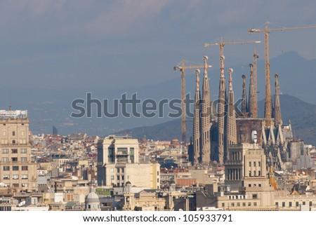 Sagrada Familia in a Cityscape, Barcelona - stock photo