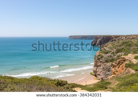 Sagres, Algarve, Portugal May 1, 2014: Beliche beach in the Algarve region of Portugal. A view of people surfing from the top. - stock photo