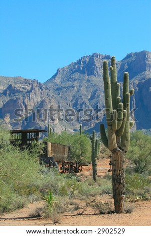 Saguaro cactus and abandoned gold mines dot the landscape surrounding the Superstition Mountains in the hot, arid desert of Arizona. - stock photo