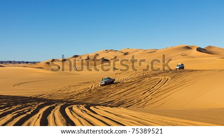 Sahara Desert Highway - Rush hour in the Awbari Sand Sea, Sahara, Libya - stock photo