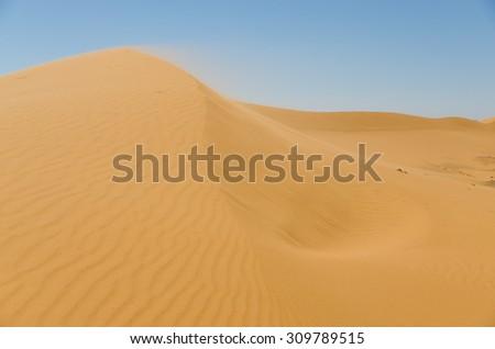 Sahara desert landscape with blue sky. Dunes background. - stock photo