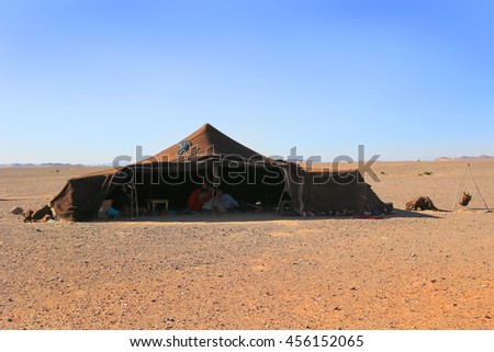 SAHARA DESERT, MOROCCO - MARCH 1, 2016: Family living in  a Berber tent in the Sahara Desert, Morocco, Africa