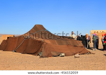 SAHARA DESERT, MOROCCO - MARCH 1, 2016: People visiting a Berber tent in the Sahara Desert, Morocco, Africa - stock photo