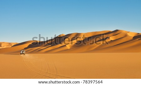 Sahara Desert Safari Adventure - Off-road vehicle driving in the Awbari Sand Sea, Libya - stock photo