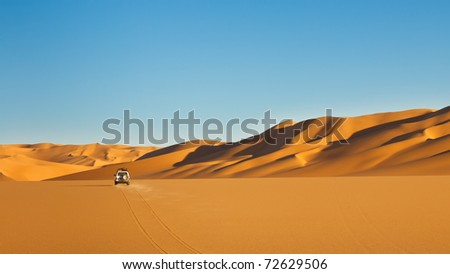 Sahara Desert Safari - Off-road vehicle driving in the Awbari Sand Sea, Libya - stock photo