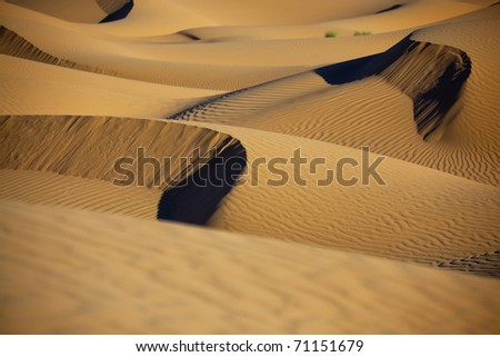 Sahara desert sand dunes in daylight with shadows. Concept for holiday and adventure traveling. - stock photo