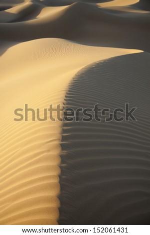 Sahara desert sand dunes with dark shadows, Morocco. - stock photo