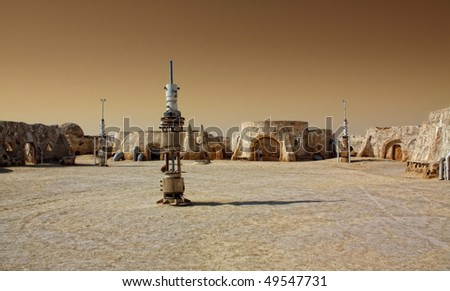 SAHARA, TUNISIA - OCT 18 : Abandoned sets for the shooting of the movie Star Wars in the Sahara desert on a background of sand dunes. - October 18, 2008 in Sahara, Tunisia - stock photo