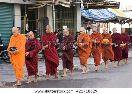 SAIGON,HO-CHI-MINH-CITY, VIETNAM - APRIL 14,2016:Monks on their way to beg for alms in Ho Chi Minh City, Saigon, Vietnam, Southeast Asia, Asia - stock photo