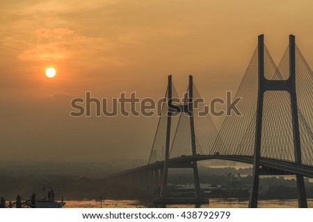 SAIGON, VIETNAM - JUNE 18, 2016 - The sunrise on Phu My bridge which is a new cable-stayed road bridge over the Saigon River in Ho Chi Minh City, Vietnam.