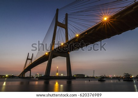 SAIGON, VIETNAM - MAR 11, 2017 - The sunset on Phu My bridge which is a new cable-stayed road bridge over the Saigon River in Ho Chi Minh City, Vietnam.