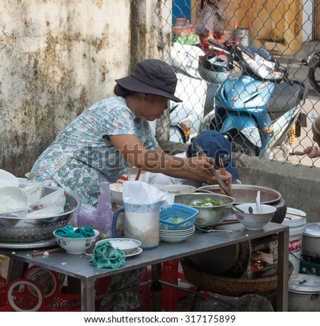 Saigon, Vietnam - May 22, 2015. A vendor selling street food in Saigon downtown, Vietnam. The street food in Vietnam looked delicious and the ingredients appeared to be fresh.